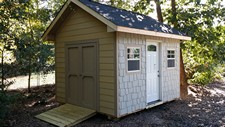 storage shed with horizontal siding and  shakes clayton